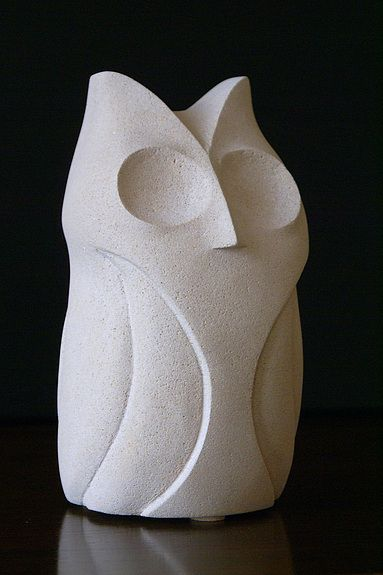 Stylized stone owl sculpture