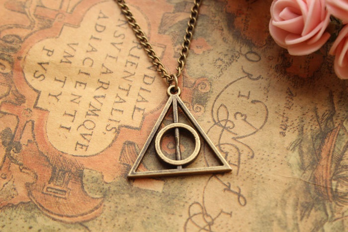 Deathly Hallows pendant necklace---N041. $4.99, via Etsy.