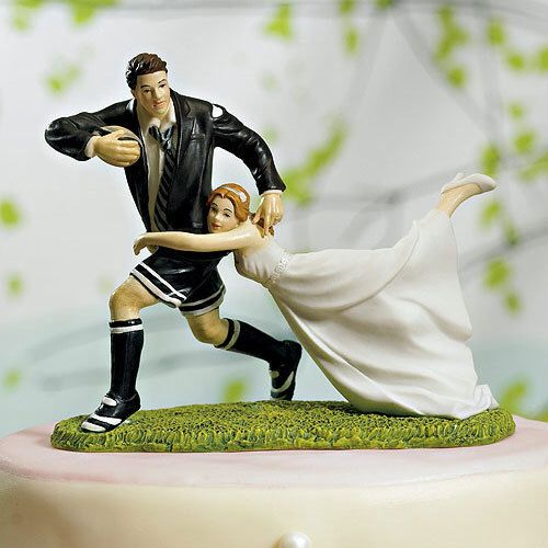 A Love Match Rugby Sports Fan Bride and Groom Wedding Cake Topper Outdoor Playful Couple Romantic Porcelain Hand Painted Figurines by splendorlocity on Etsy https://www.etsy.com/listing/193246189/a-love-match-rugby-sports-fan-bride-and