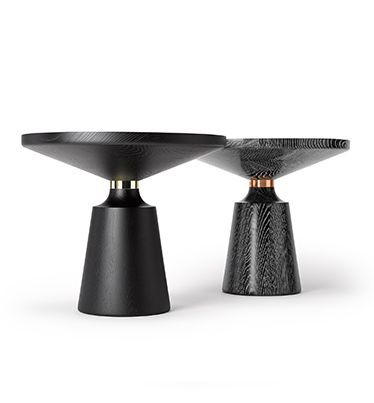 NICOLE OCCASIONAL TABLE BY STUART SCOTT. Turned by hand from solid oak or walnut, this table has a simple but graphically striking silhouette punctuated by the polished copper. Shown here in ebony limed oak and copper, and traditionally ebonised oak and brass. Handmade from thick sections of laminated oak / walnut. Built to order by hand in England. Name stamped and individually numbered. stuartscott.co.uk