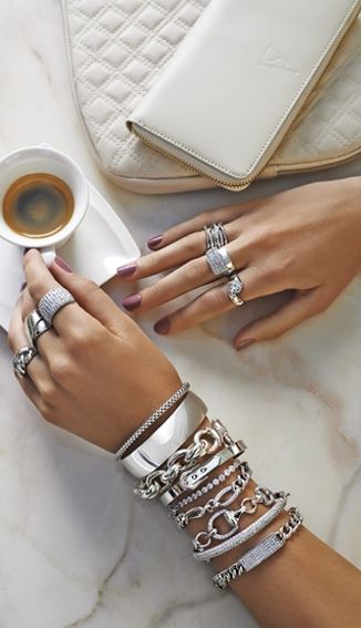 beautiful display of silver bangles & rings, the more the merrier
