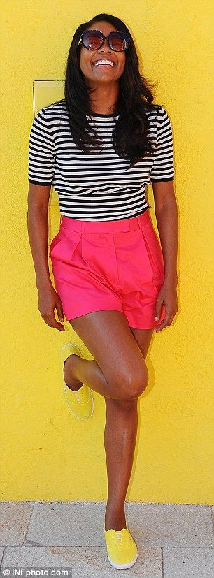 Summer streetstyle | Gabrielle Union in hot pink shorts, stripped black & white top and yellow flats