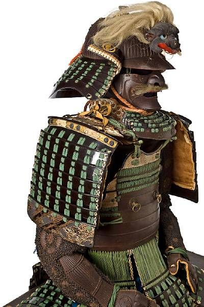 A green-laced suit of armor with a russet-iron cuirass. Helmet by Masamoto, Edo period, 18th century © 2002-2009 Bonhams 1793 Ltd