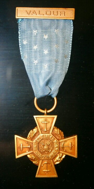 This rare Tiffany Cross variant of the Medal of Honor was earned by Marine First Lieutenant Christian Schilt. Schilt served in WWI, the Banana Wars, WWII, and Korea.   His Medal of Honor citation follows:  Citation: During the progress of an insurrection at Quilali, Nicaragua, 6, 7, and 8 January 1928, 1st Lt. Schilt, then a member of a marine expedition which had suffered severe losses in killed and wounded, volunteered under almost impossible conditions to evacuate the wounded by air and…