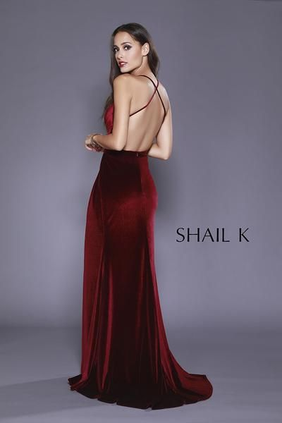 Velvet is everywhere this year, so we thought we would give you what you been asking for. This beautiful velvet gown comes with a sweetheart neckline with thin straps that criss cross in the back to add elegance like to other to this beauty.  The rouging on the top and bottom of the belted waist adds so much glamour.