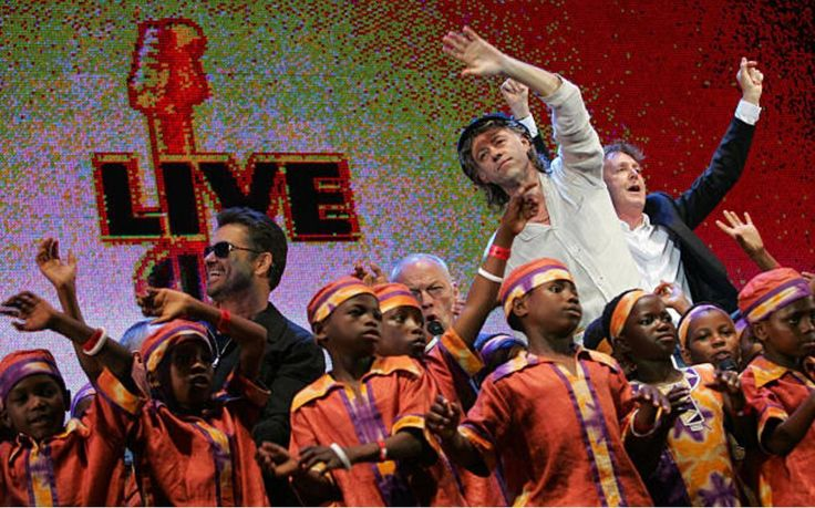 "thegeorgemichaelblog: ""George, David Gilmour, Bob Geldof, Paul McCartney and an African children's choir onstage during Live 8, July 2, 2005, 20 years after the last Live Aid. """