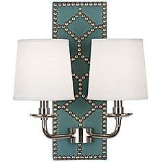 This leather studded backplate could be replicated and the fixture mounted to it. Lightfoot Polished Nickel and Teal Leather 2-Light Sconce