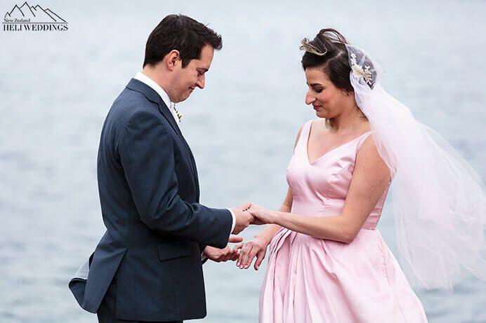 Moke Lake Wedding Ceremony Brode & Groom exchanging rings in Queenstown New Zealand