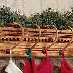 christmas sock hanger for mantle - this is an awesome idea being that most of them wont hold a full stocking