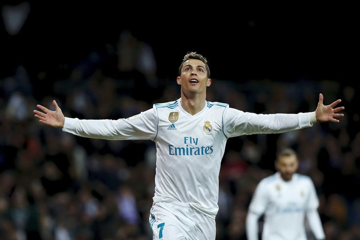 Cristiano Ronaldo Photos - Cristiano Ronaldo of Real Madrid CF celebrates scoring their fourth goal during the La Liga match between Real Madrid CF and Real Sociedad de Futbol at Estadio Santiago Bernabeu on February 10, 2018 in Madrid, Spain. - Real Madrid v Real Sociedad - La Liga