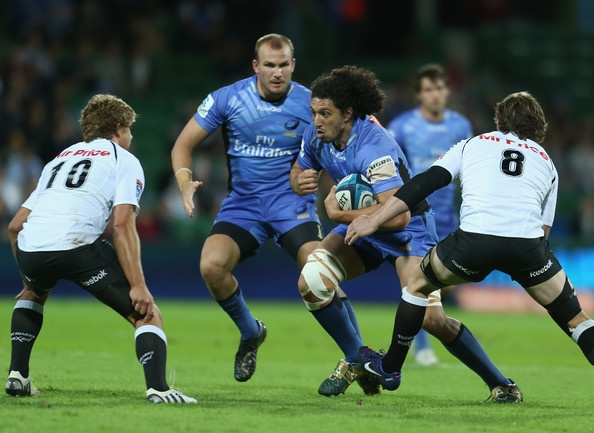 Sam Wykes of the Force is tackled during the round 14 Super Rugby match between the Force and the Sharks at nib Stadium on May 17, 2013 in Perth, Australia.