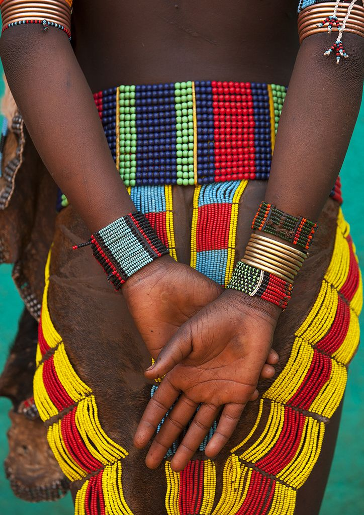 Africa | Hamer girl's skirt and jewellery. Turmi. Omo Valley. Ethiopia | © Eric Lafforgue