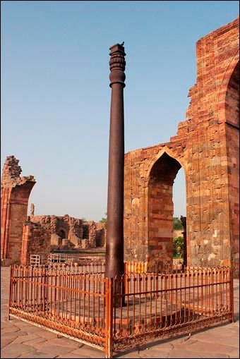 The Iron Pillar of Delhi in the courtyard of the Quwwat-ul-Islam Mosque