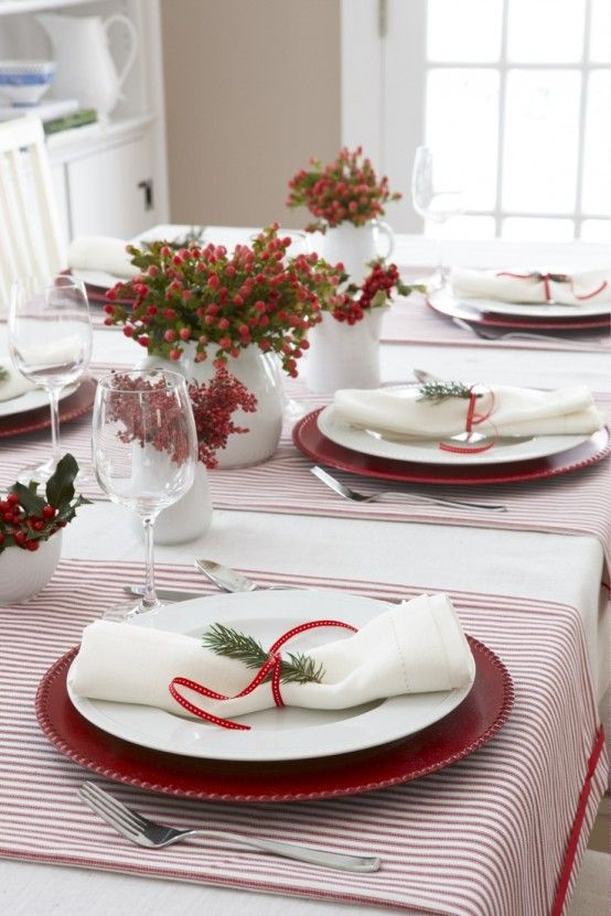 Very simple and beautiful! Love the little sprig of evergreen on the napkin and the tiny red ribbon.