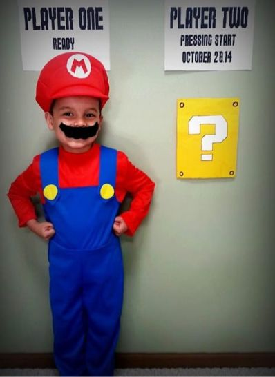 """if you're expecting number one you can always dress up with your husband as mario and Luigi and add a """"player 3"""" with the """"?"""" :)"""