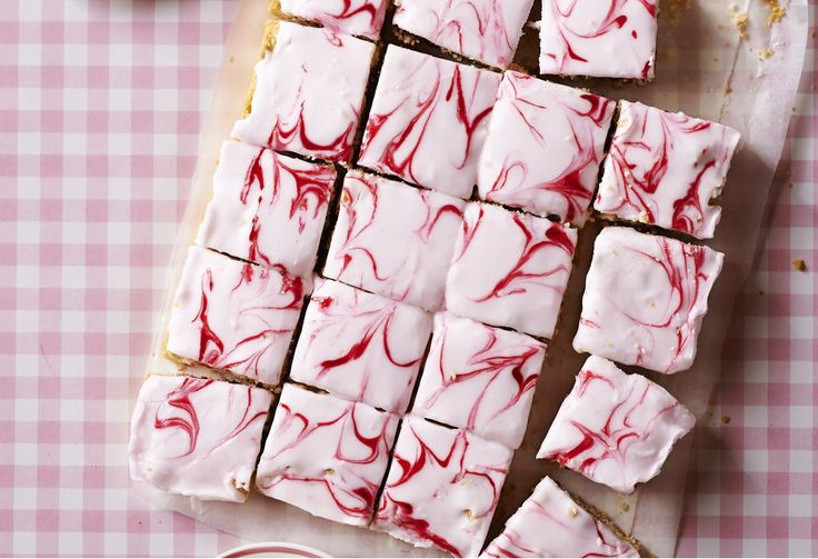 A pretty in pink classic slice with retro marble icing and a layer of raspberry jam.