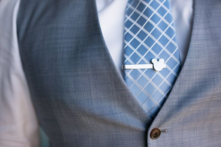 A tiny hidden Mickey on this groom's tie clip