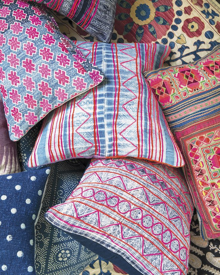 Interior designer Amber Lewis is feeding my textile fetish with her collection of pillows, made from vintage fabrics all over the world. The combination of bright boho colors and rich textures, from Malian indigo mud cloth, Laotian Hmong batik, Turkish kilims, and Indian hand blockprints, is everything