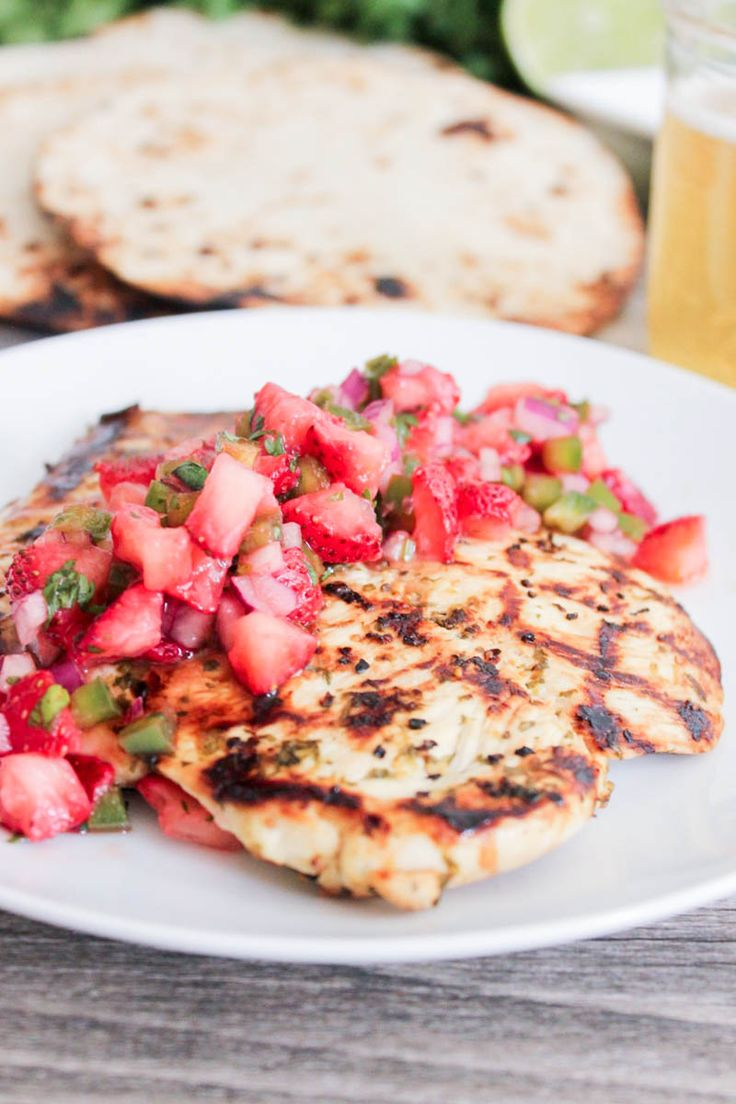 Cilantro-Lime Grilled Chicken with Strawberry-Jalapeño Salsa. Light, fresh and perfect for summer! #SummerSoiree #Chicken