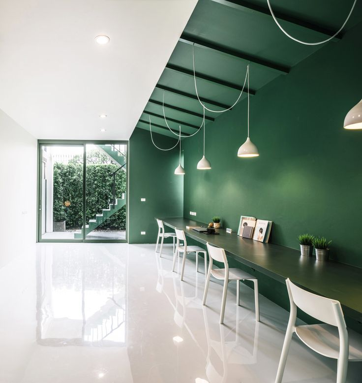 Splashes of green are used throughout this Thai TV production office, which…