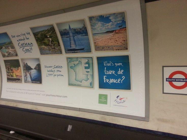 """Dans le cadre de son partenariat avec le  Cluster Tourisme Littoral, l'Office de Tourisme de Porto-Vecchio participe à l'opération """"What's Your Tour de France"""". Le dispositif d'action comprend un affichage dans le métro londonien. Ici l'affiche à South Wimbledon (zone 3)"""
