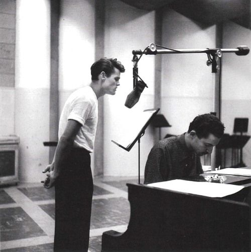 Chet Baker recording vocals with Russ Freeman at the piano, Los Angeles, 1954, photo by William Claxton
