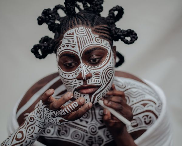 """Portraits employing the Sacred Art of the Ori by Laolu Senbanjo.  """"My Art form is physically drawing what's on the inside, what's in your soul, and your essence and being;  on your canvas which is the skin."""""""