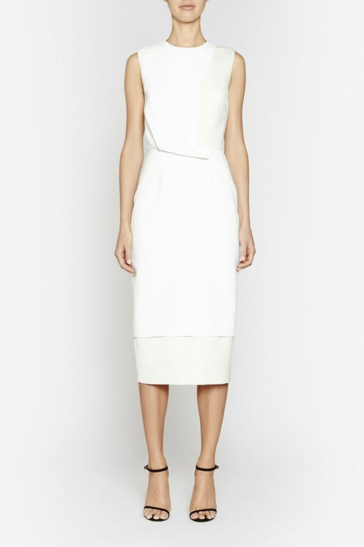 Camilla and Marc | VORTEX DRESS  US$566.49 Classic dress designed in a white twill with contrasting panels in a textured honeycomb fabric. Created in a streamlined silhouette, this piece features a round neckline, draped front, multi-layered skirt and double slit at the back of the skirt. Includes an invisible zipper fastening at the centre back of the bodice.