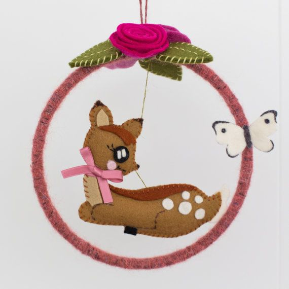 Baby deer baby mobile in deep pinks from Babes in the Woods. $39