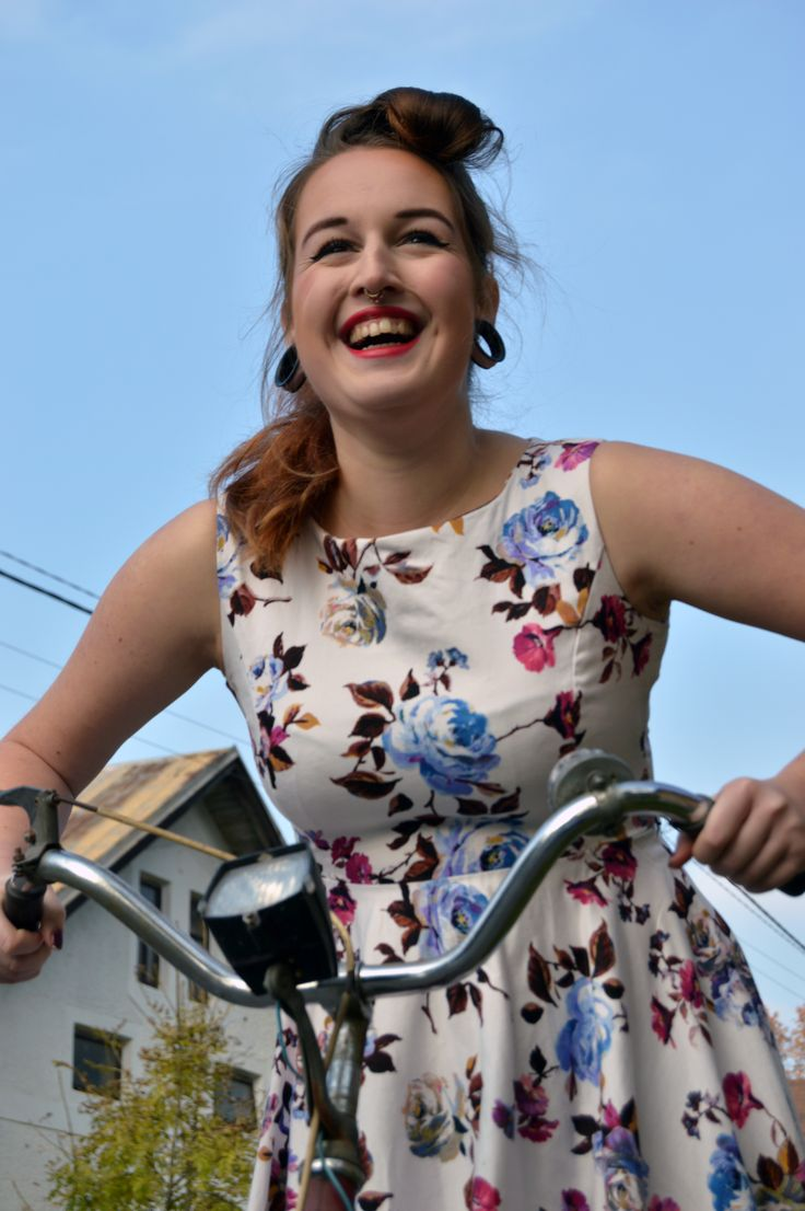 Pin up fashion photoshooting with old bicycle.