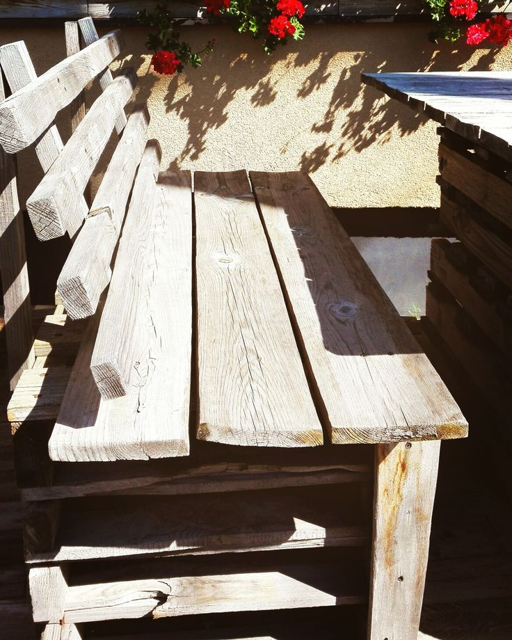 A simple rustic bench made of reclaimed pallets.
