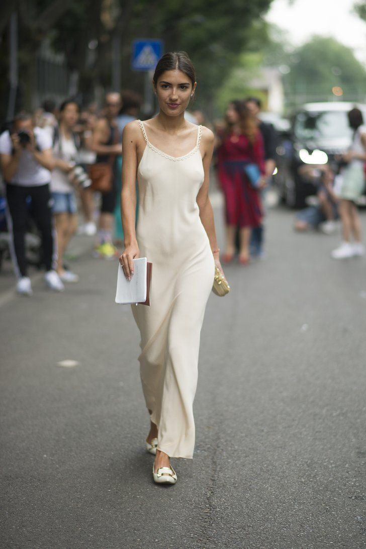 Pin for Later: 58 Flawless Ways to Style the End of Summer Summer Street Style A slinky slip dress and flats are the perfect measure of fashion and function.