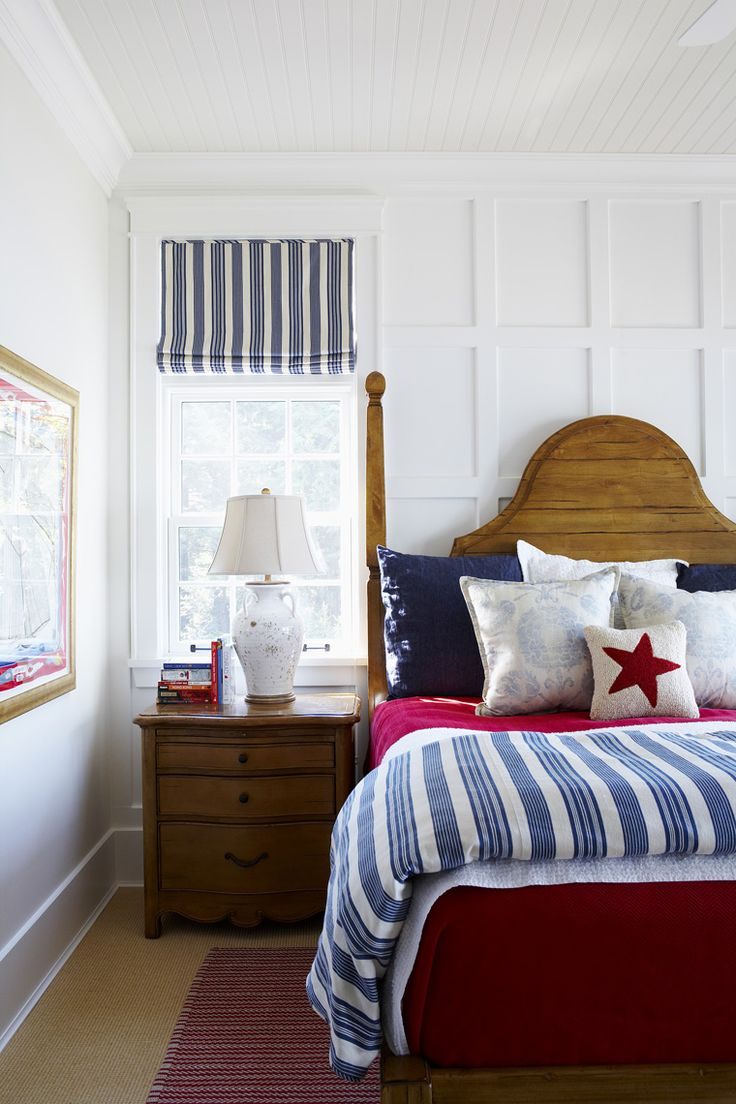 Red, white and blue bedroom with lovely detail on the ceiling and feature wall!