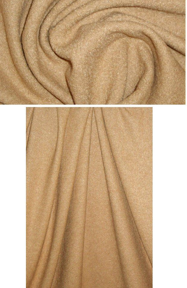 Simply fabulous!! This is a viscose/wool boucle' knit in a sophisticated camel tone (PANTONE 17-1328). It's a medium suiting weight KNIT with a low pile boucle' texture, and it has lovely drape with body. It is identical on both sides, so fully reversible, and has 20% stretch widthwise, 10% lengthwise. Perfect for an unlined indoor jacket or cardigan, knit suit, poncho, etc., and since it doesn't fray, you can either hem or leave the edges unfinished.