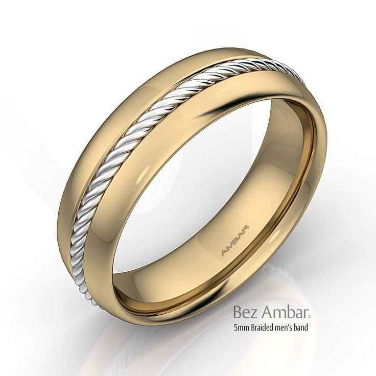 A beautiful men's gold wedding band with two-tone metal 18k yellow gold and a braided wire in 18k white gold around the center of the band. A Bez Ambar design.