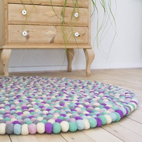 Purple, turkis, white & pink rug from Una LIVING Felt ball rug: http://unaliving.com Kugletæppe: http://unaliving.dk Filzkugelteppich: http://unaliving.de We have 14 different designs
