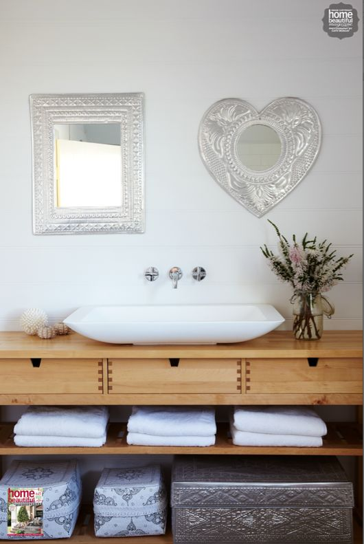 Exposed shelving in this bathroom looks neat and pretty