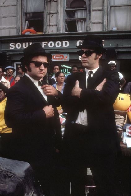 Jake, Elwood, and the Bluesmobile's rear right-side bumper.