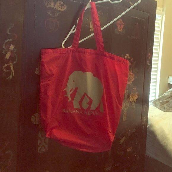 Banana Republic tote bag in red with elephant Windbreaker material. Red. Never used. Super cute! Perfect for grocery shopping or over night bag! Let me know if you have any questions !!  Banana Republic Bags Totes