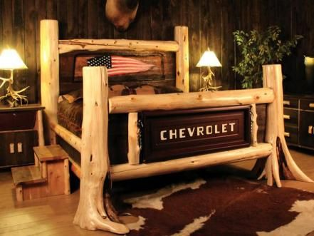 Cedar logs are mixed with a tailgate from an old pickup truck to make a one-of-a-kind, four-post bed. Design by Tommy Mitchell of Log Heads.