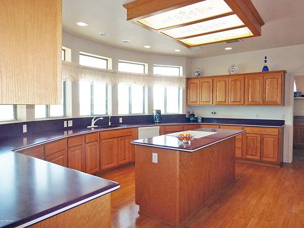 2265 s/f 3BR + bonus rm custom home on 4 acres w/panoramic mtn views. Large kitchen w/plenty of cabinets, center island, & walk-in pantry. Corian counters, & wood laminate. $232,500. Call Mary Renn, 520-249-7640, or email renn.mary@gmail.com. www.SierraVistaHomeSales.com. Tierra Antigua Realty. Direct MLS link at www.AZrealestatepress.com. Get more info on page 18 of the current REP.