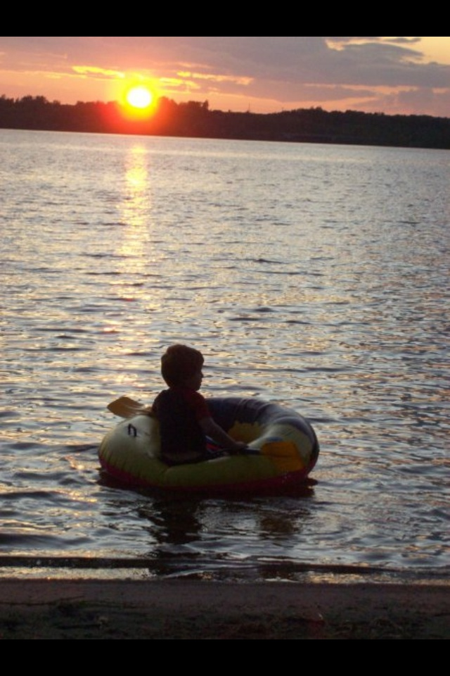 Sunset at Lake of the woods, Ontario. My little guy! Beach front@ Kertz cabin.