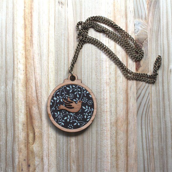 Kosbaar | Pendant Necklace |  Timber & fabric inlay with timber veneer bird design | Floral patterned background  |  Handmade in Cape Town, South Africa
