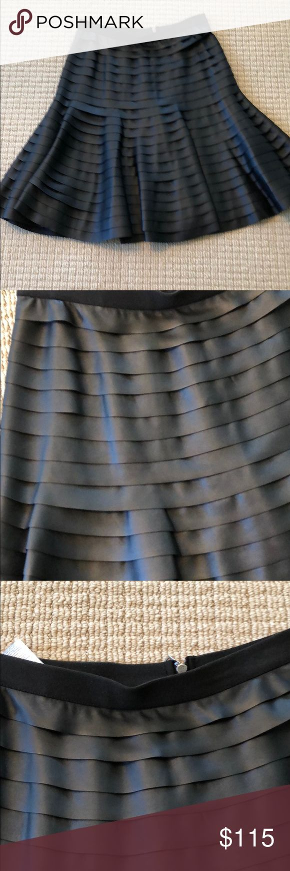 """BCBG faux leather skirt size xxs BNWT Brand new with tags from Bloomingdales  BCBG  black Faux leather layered skirt size XXS. Fits snug up top then flares out. Great stylish skirt. Hits me below knee and I am 5'4"""". Perfect condition. Zipper in back and waist stretch fabric. Originally it was $228. BCBGMaxAzria Skirts A-Line or Full"""