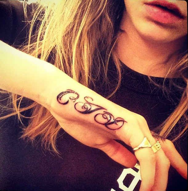 She's got two tattoos on her hand, both inked by Bang Bang.