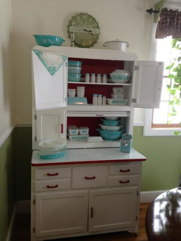 I love this Hoosier Cabinet....with all the vintage Pyrex! Dreaming here! This is a great idea for mine that I am waiting to paint!