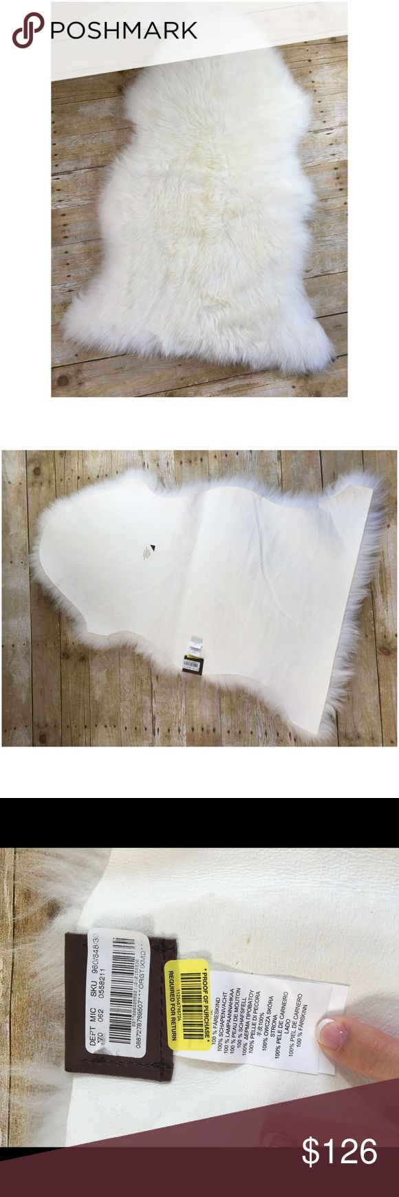 """UGG Australia Home Sheepskin Rug Natural Beige Top of the line quality sheepskin rug. The fur origin is New Zealand while the product was made in China. If you're going to buy a sheepskin rug, might as well buy it from the manufacturer of the best selling sheepskin boots! This rug is seriously luxurious and adds richness to any room. I place mine at the foot of the bed, in the living room, and draped over a nice chair.   Condition: New with tags  Size: 2"""" by 3"""" (Small)  Material: 100%…"""