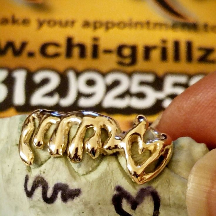Got your heart set on dripping wet Grillz.. You'll love this design drip and cut out heart style. Custom fit gold teeth 6k - 22k gold silver or platinum  www.ChiGrillz.com