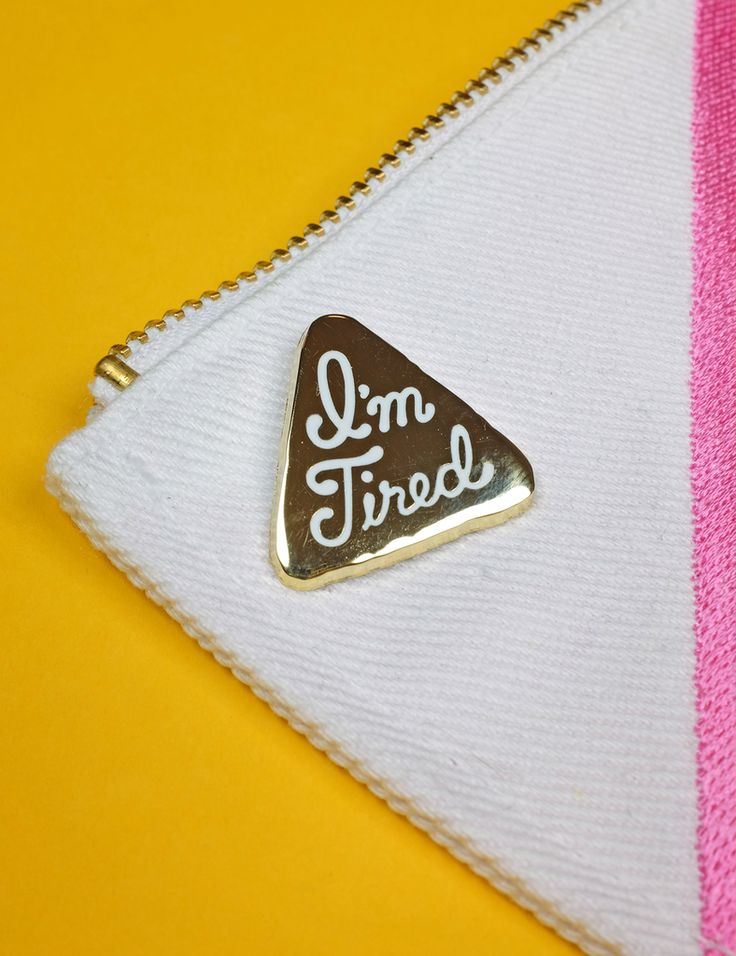 """I'm tired are you? The perfect pin to match your attitude.-1"""" hard enamel pin-Gold colored metal-2mm thick-Rubber pin backingMade in the USA."""