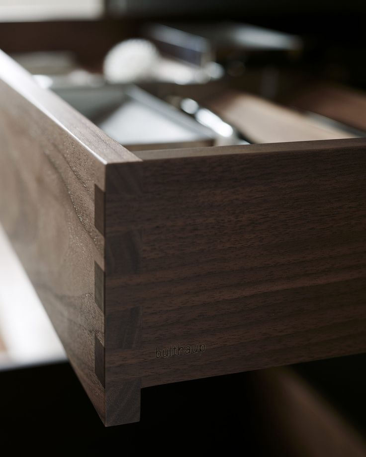 Handcrafted walnut internal drawers in a bulthaup b3 kitchen.